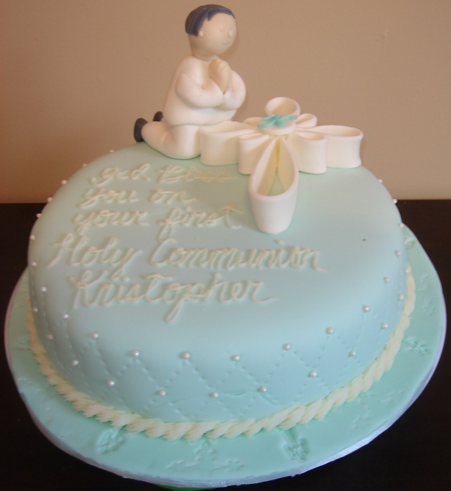 Figure and cross gumpastecarrot cake with cream cheese icing covered
